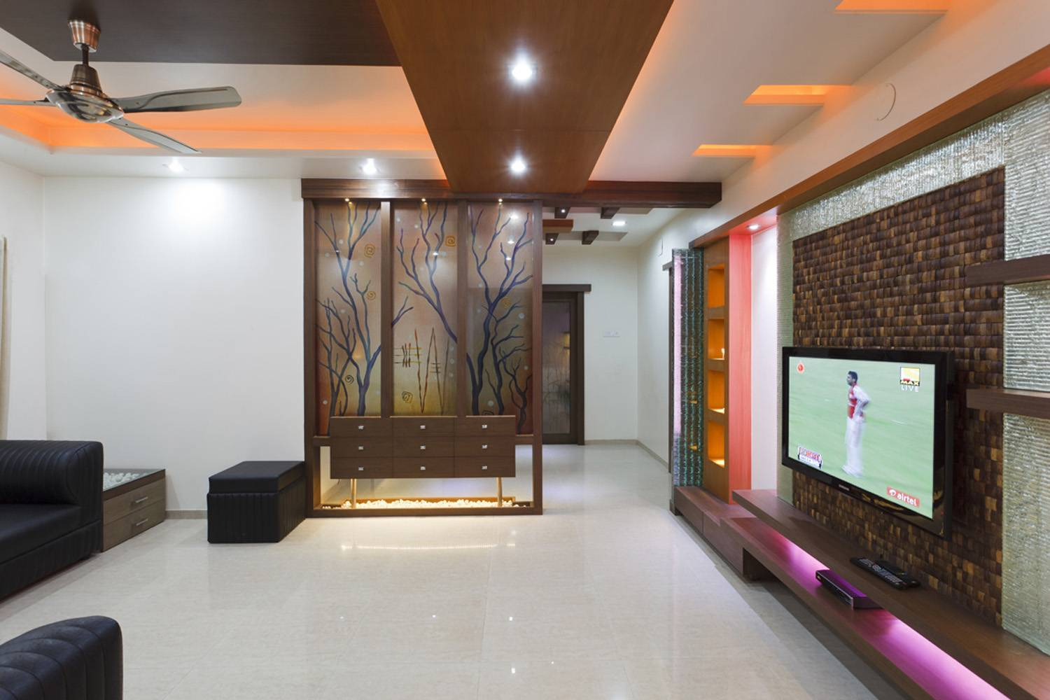 Interior designs for living room tv room interiors pune for Interior designs living rooms