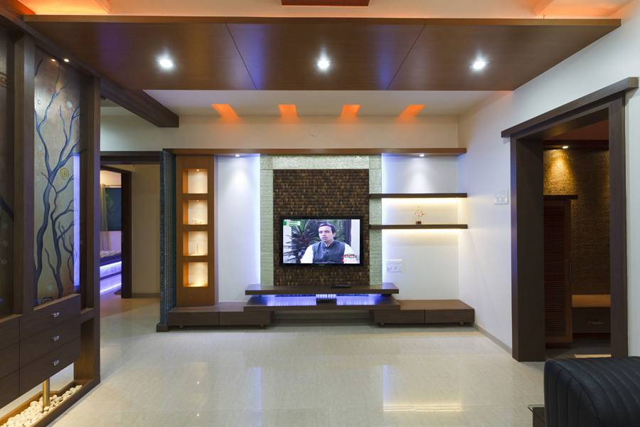 Interior designs for living room tv room interiors pune for Interior design of living room with dining